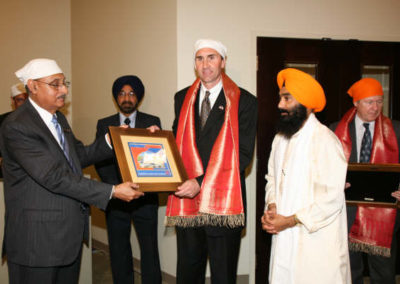 Chairman, GSSWH Board of Trustees, Prithvipal Singh Likhari presenting plaque to  Congressman, Pete Olson; GSSWH Bhai Sahib, Bhai Sukhdev Singh looks on