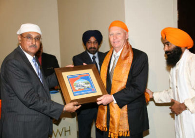 Chairman, GSSWH Board of Trustees, Prithvipal Singh Likhari presenting plaque to  Mayor of Sugar Land, James P. Thompson, GSSWH Bhai Sahib, Bhai Sukhdev Singh looks on