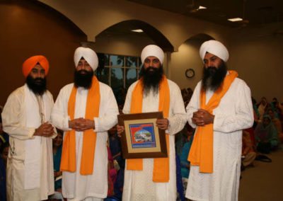 L to R: GSSWH Bhai Sahib, Bhai Sukhdev Singh, Sant Anoop Singh Ji Unawale (with plaque)  flanked by his companions